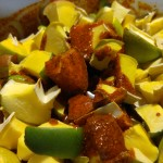 Add raw mangoes and garlic.