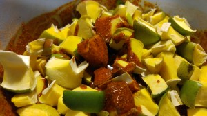 Add raw mangoes and garlic.